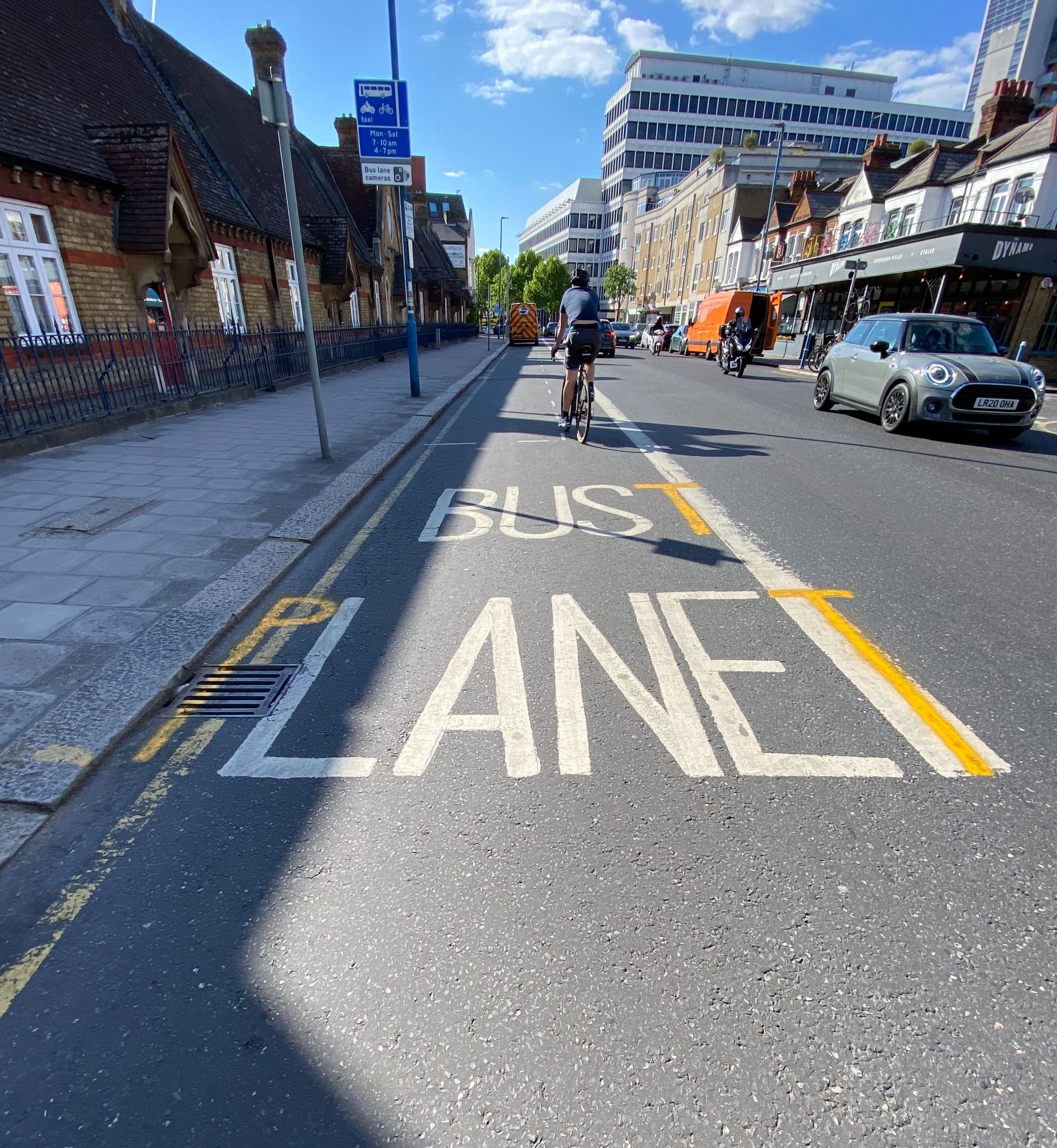 A bus lane in Putney is repurposed to express concern over covid or possibly the environment.